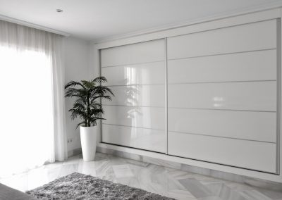 Gloss sliding wardrobesMarbella bedroom Palm 1
